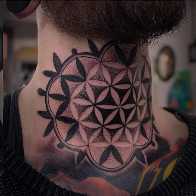 Blackwork sacred geometry neck tattoo
