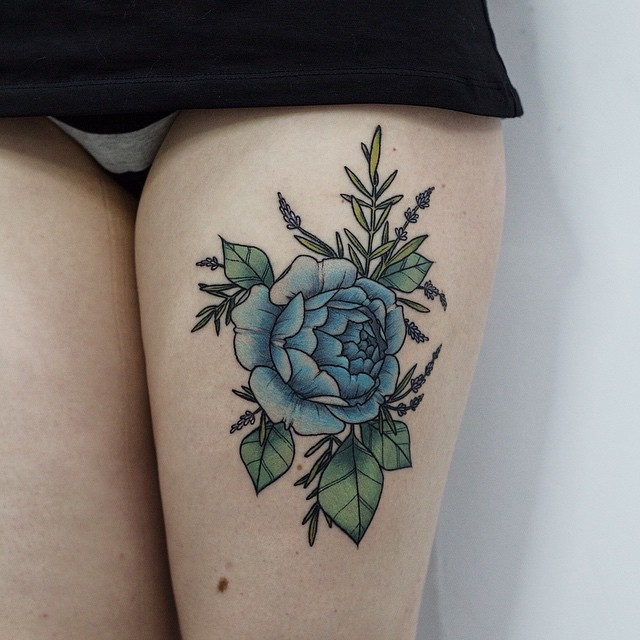 Blue rose tattoo on the thigh