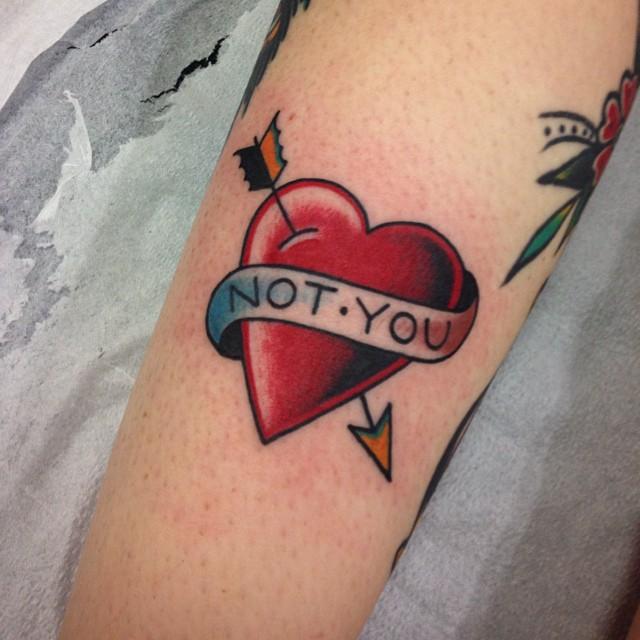 Broken heart tattoo