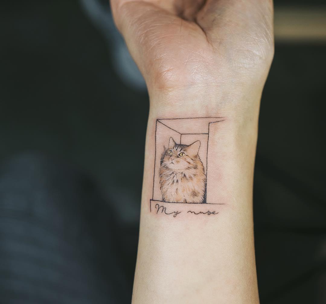Cat in a box tattoo