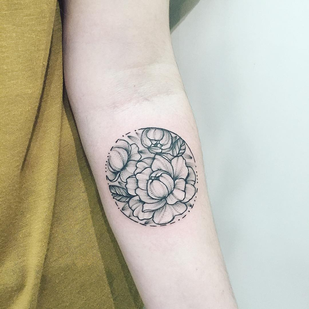 Circular black and grey flower tattoo