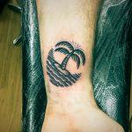 Circular island with a palm tree tattoo
