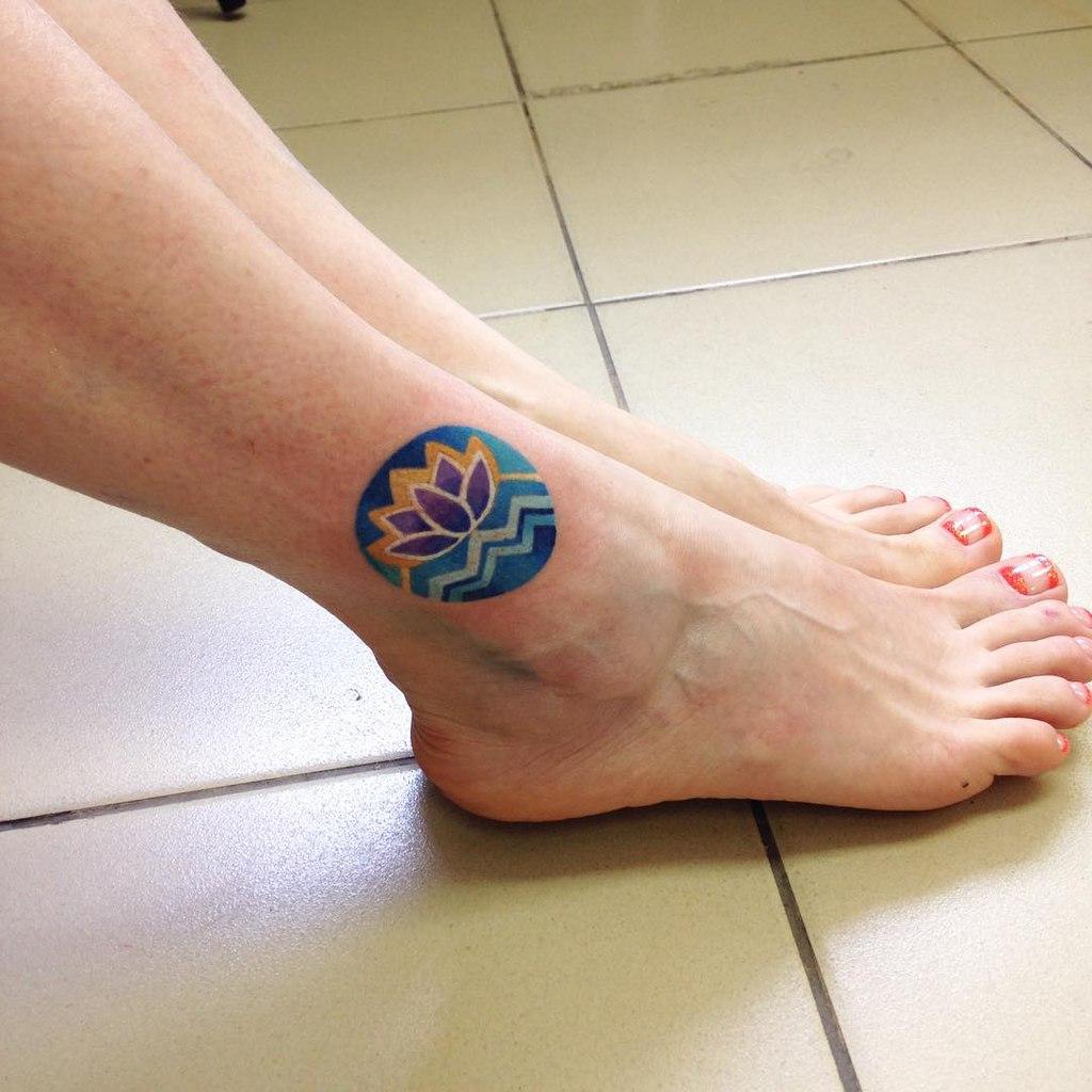 Circular lotus flower tattoo
