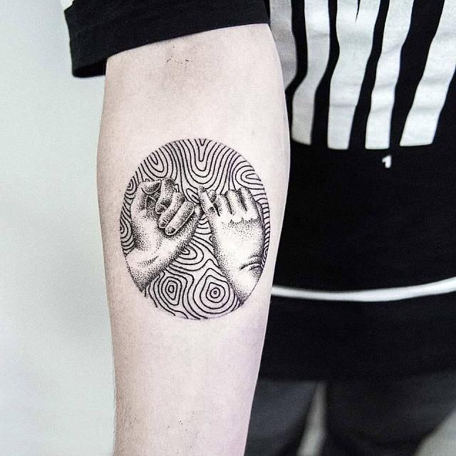 Circular pinky promise tattoo