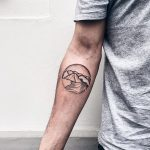 Circular wave and mountain tattoo