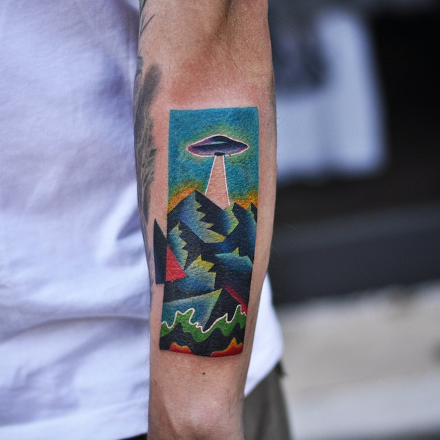 Colorful alien abduction tattoo