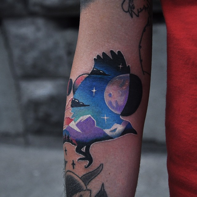 Colorful bird tattoo with a landscape
