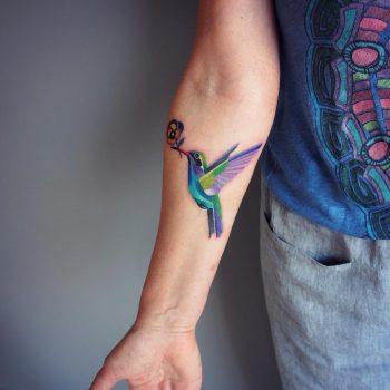 Colorful colibri tattoo