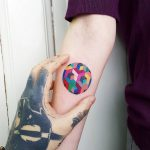 Colorful geometric circle tattoo