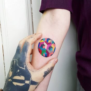 Colorful geometric circle tattoo