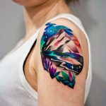 Colorful landscape arm tattoo