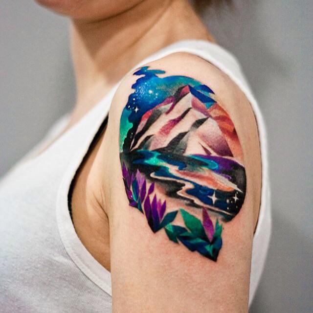 Colorful landscape arm tattoo