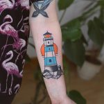 Colorful lighthouse tattoo