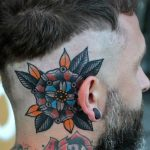Colorful mandala behind the ear tattoo