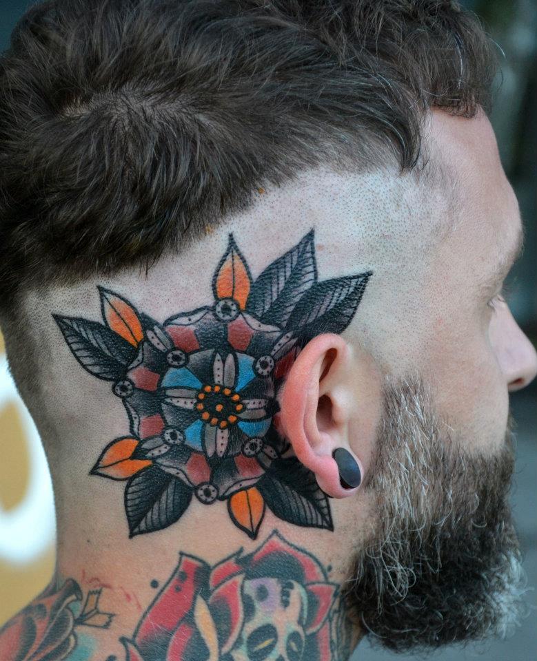 Colorful mandala behind the ear tattoo