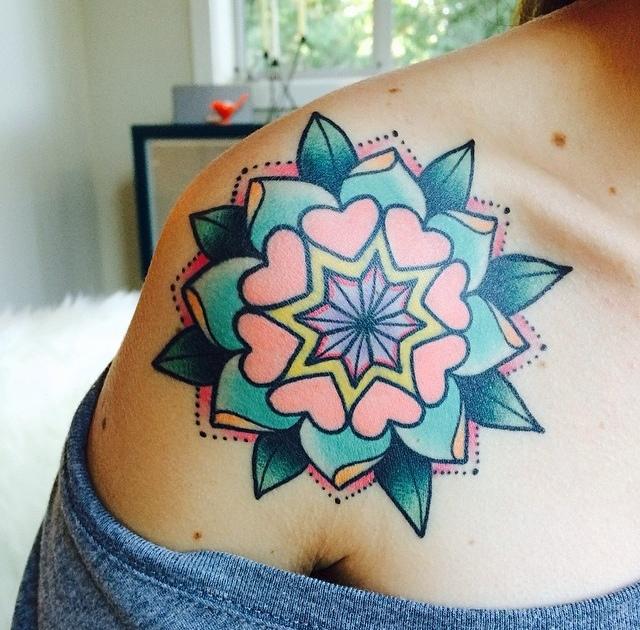 Colorful mandala tattoo on the shoulder