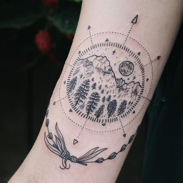 Compass and mountains tattoo