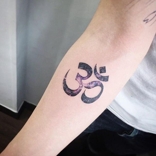 Cosmic om tattoo