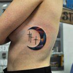 Crescent moon and three stars tattoo