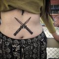 Crossed knives tattoo