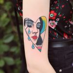 Crying woman in a heart tattoo