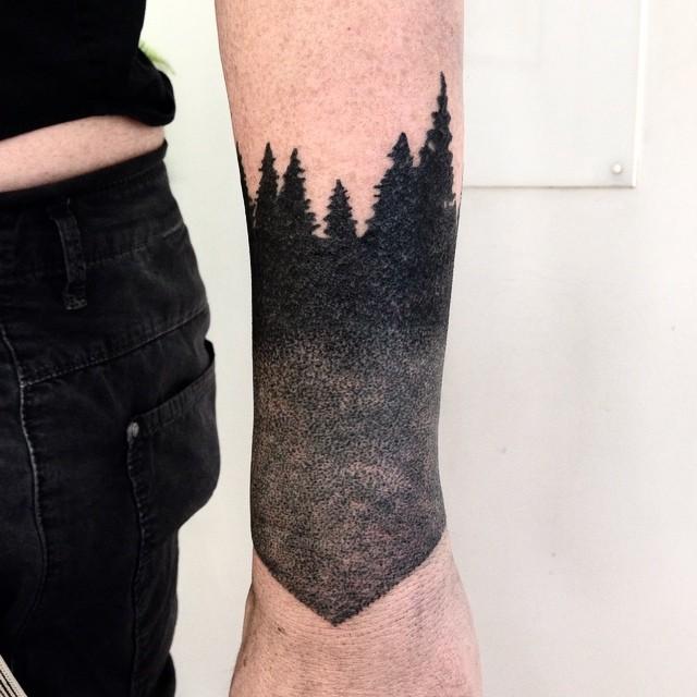 Dark forest wrist tattoo
