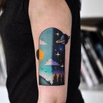 Day and night sky tattoo
