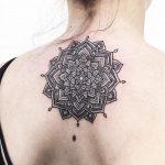 Delicate black mandala tattoo on the back