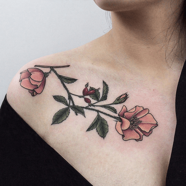 Delicate flowers collarbone tattoo
