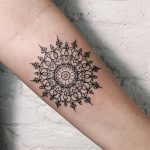 Delicate geometric circled pattern tattoo