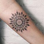 Delicate geometric circled pattern tattoo