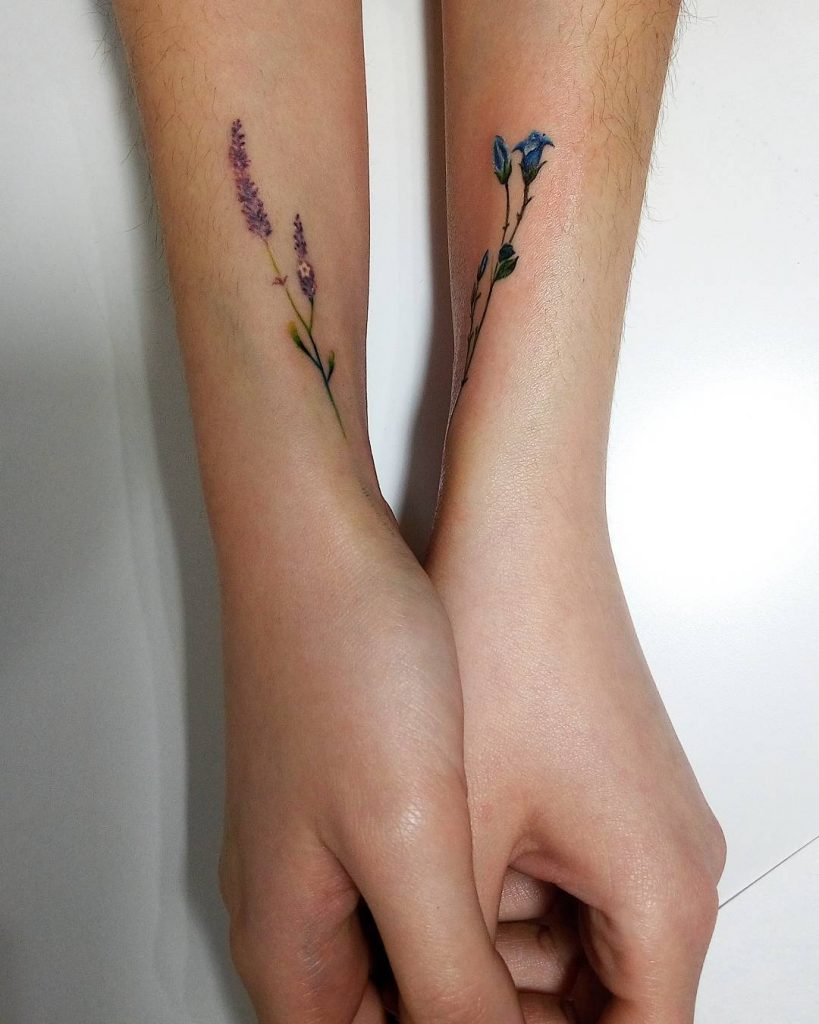 Delicate violet and blue flower tattoos