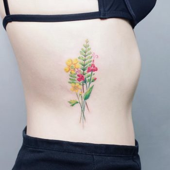Delicate wildflowers bouquet tattoo on the side