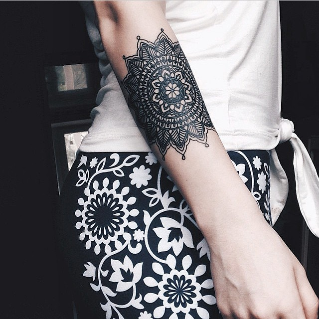 Detailed black mandala tattoo