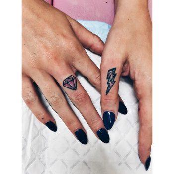 Diamond and lightning bolt tattoo