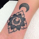 Dotwork flower and crescent moon tattoo