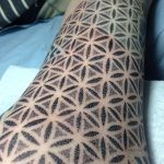 Dotwork sacred geometry arm tattoo