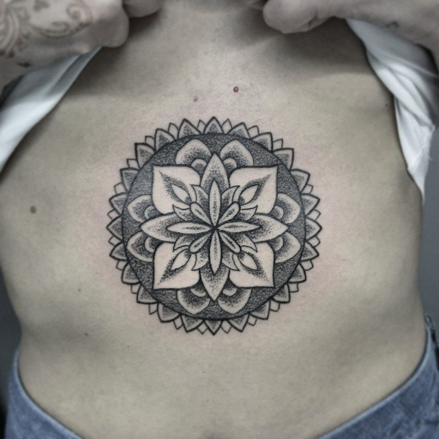 Dotwork style floral mandala belly tattoo