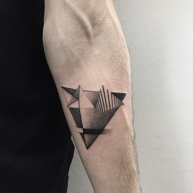 Dotwork style geometric tattoo on the forearm