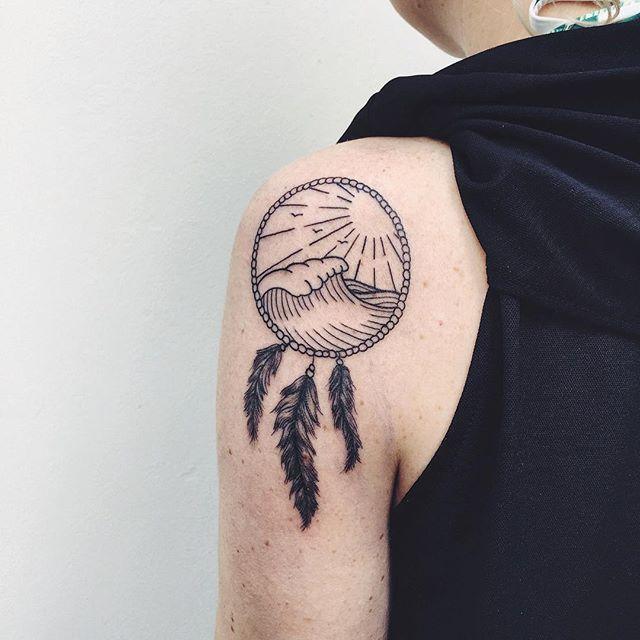 Dreamcatcher tattoo on the left shoulder