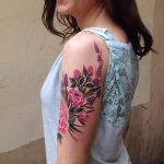 Excellent flower tattoo on the upper arm