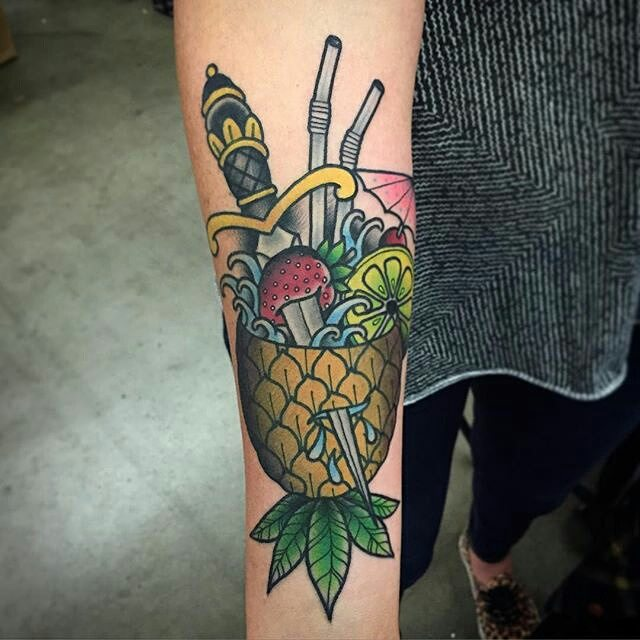 Exotic cocktail and dagger tattoo
