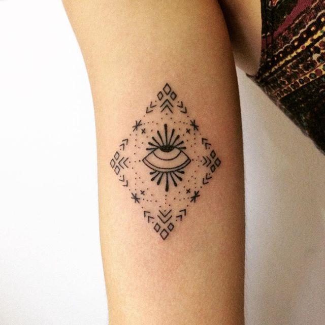 Eye in a rhombus tattoo