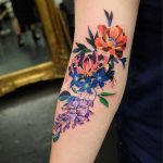 Fantastic flower tattoo on the arm