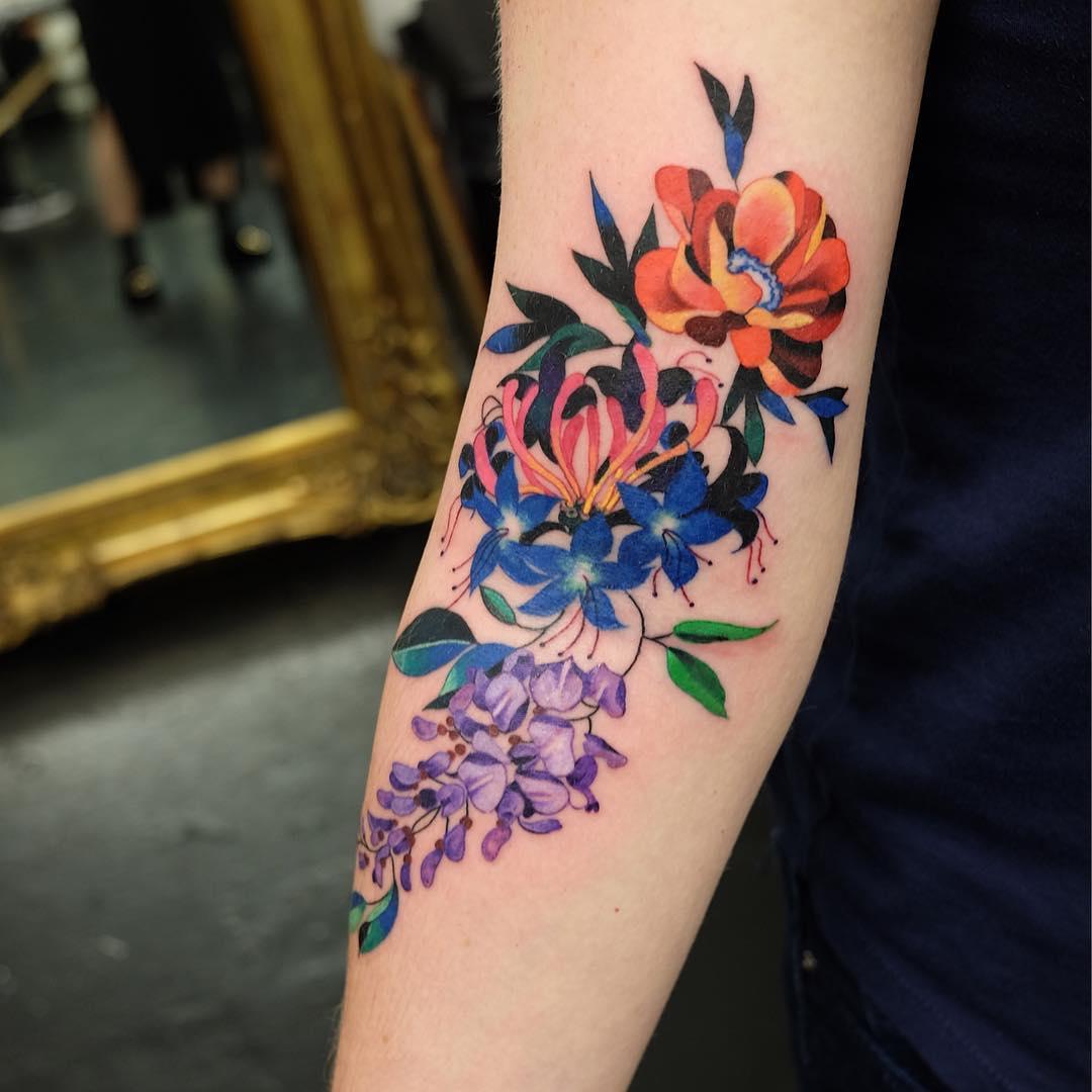 Fantastic flower tattoo on the arm