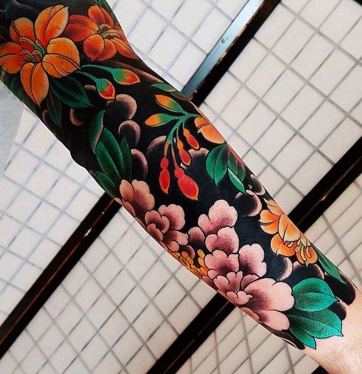Fantastic full sleeve floral tattoo