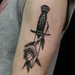 Fine dagger and rose tattoo
