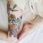 Floral tattoo on the right thigh