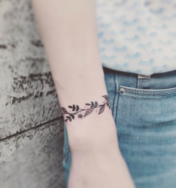Floral wristband on the right arm