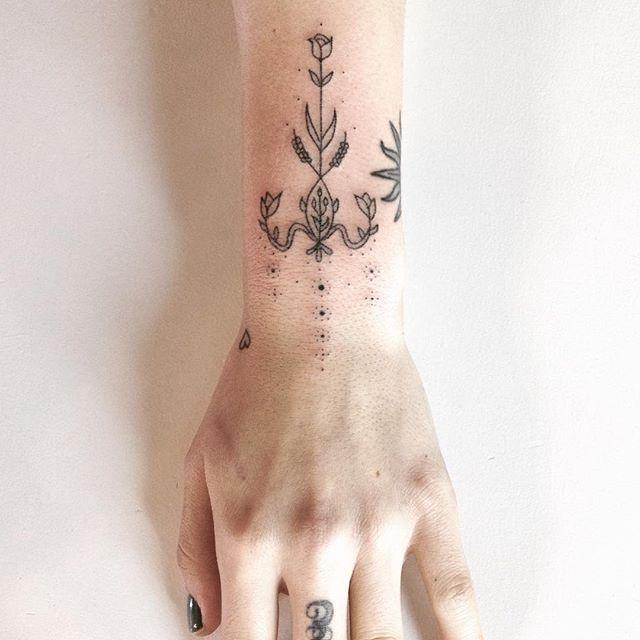 Flower black ornament tattoo on the wrist